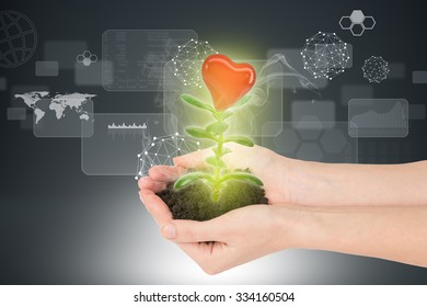 Womans hands holding plant with ground and heart on abstract background