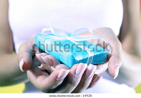 woman's hands holding small gift