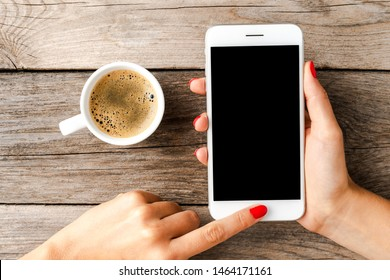 Woman's hands holding smart phone with empty screen.