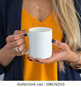 womans hands holding a white mug, perfect for displaying your quote, design on mugs you sell.