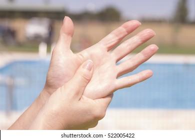 Woman's hands massaging