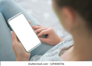 woman's hands Mockup image of smart phone. close up. chroma key. holding mobile phone white screen smartphone.
