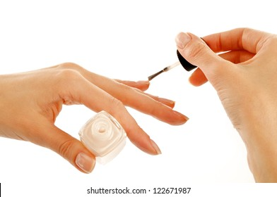 Woman's Hands Painting Flesh Color Nail Polish isolated on white background