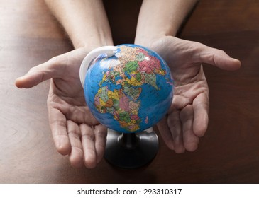woman's hands and palms focusing on the environment for worldwide peace and protection of nature