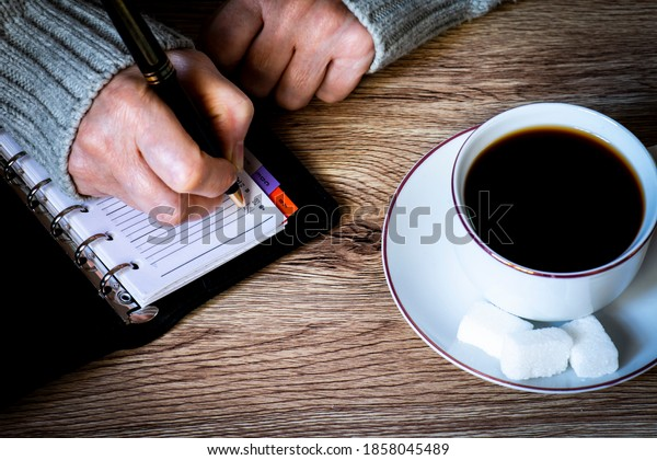 womans-hands-pen-writing-on-600w-1858045