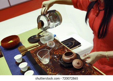 Woman's hands preparing Chinese tea