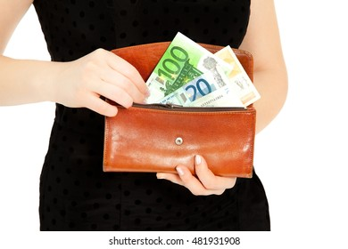 Woman's hands with purse and money isolated on white