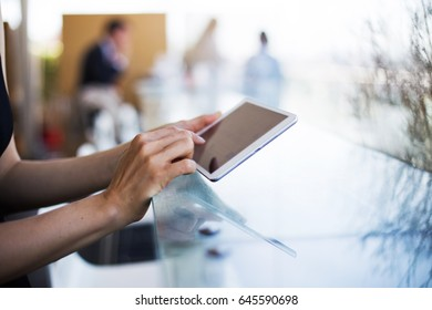 Woman's hands with a tablet