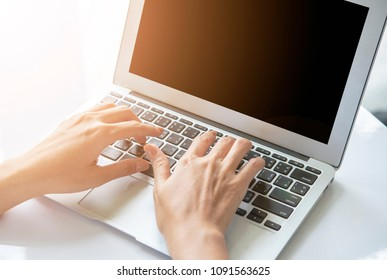 Woman's hands typing on laptop keyboard. Working concept.