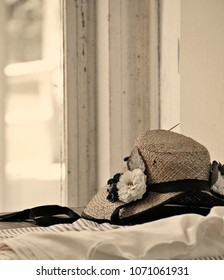 A woman's hat sits on a window sill at the site of a recreation of a Civil War battle and camp in Virginia.
