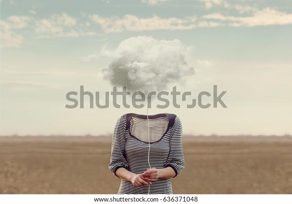 Woman's head hidden by a soft cloud