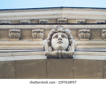 woman's head on the bas-relief of the building