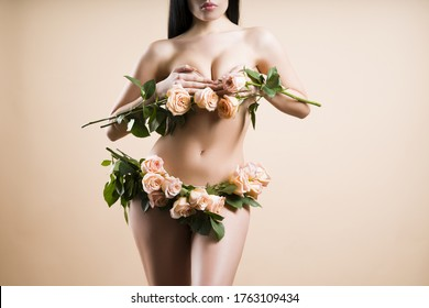 Womans health and beauty. Erotic concept. Gynecology concept. Young woman with flower on color background. Panties with roses. Gynecology, menstruation, the concept of woman genital health