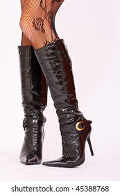 Woman's high heel black leather boots