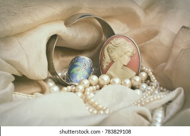 Woman's Jewellery. Vintage jewellery with cameo brooch, silver ring and genuine pearls