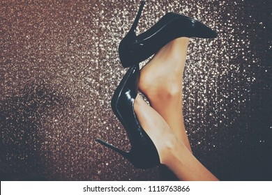 Woman's leg and high heel shoes. Sexy female legs in black boots. Sensual. Erotic concept. Erotic sex game. Fashion shoes. Sensuality. Adult. Sexy photo. Beauty female. Fashion. Background. Sex.