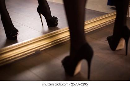 Woman's leg in high heel stiletto fetish boots