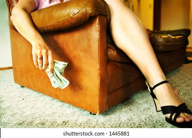 Woman's Legs and arm holding cash. Cross proccessed effect.
