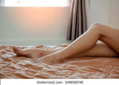 A woman's legs in bed get up in the morning.wake up in the morning