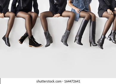 Woman's legs in different shoes