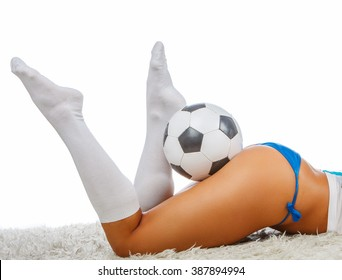 Woman's legs and football.