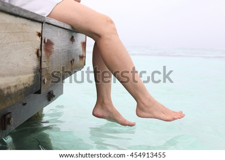 c655ee1c952 Womans Legs Hanging Into Sea On Stock Photo (Edit Now) 454913455 ...