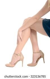 Woman's legs, high heels, pain in leg