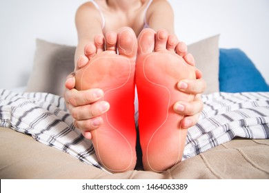 Woman's legs hurts, pain in the foot, massage of female feet at home