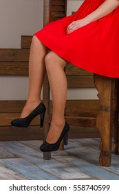 Woman's legs on black high heels shoes