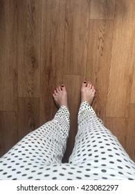 Woman's legs in pajama pants