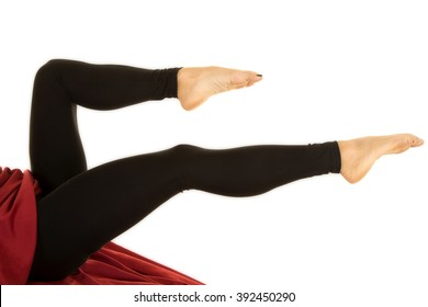 a woman's legs pointed in her black fitted leggings.