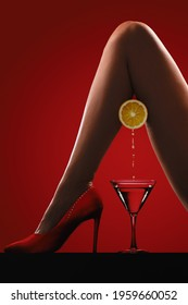 Woman's legs in red high heels with a glass of wine
