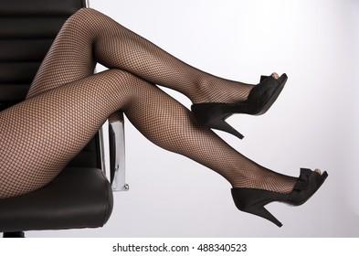 Woman's legs wearing fishnet tights