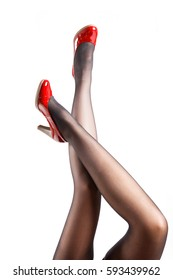 Woman's Legs Wearing Pantyhose and High Heels with space for text