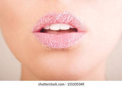 Woman's lips strewed with sugar