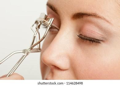 Woman's Make Up.���¡orrection of eyelashes.Isolated on white