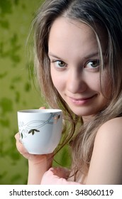 Woman's morning with cup of tea