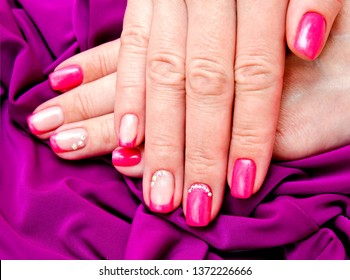 Woman's nails with beautiful manicure fashion design with gems