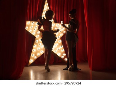 Womans on stage with broadway star on background