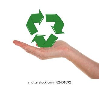 Woman's opened hand holding recycling symbol
