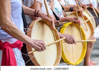 Womans percussionists playing drums during folk samba performance on Belo Horizonte, Minas Gerais