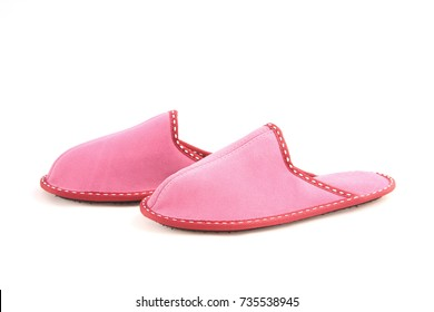 Woman's pink leather slippers isolated on white background