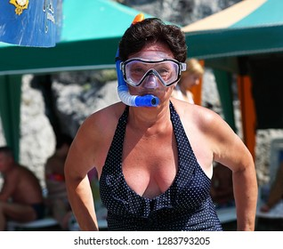 Woman's portrait, woman in swimming suit, diving mask