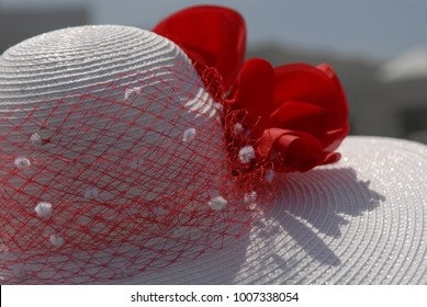 A woman's red hat at the Kentucky Derby in Louisville, KY.