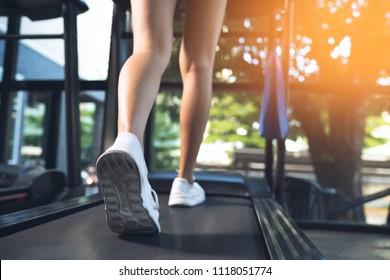 Woman's running on treadmill