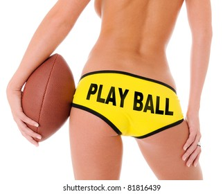 Woman's Sexy Backside Holding a Football and Yellow shorts that reads Play Ball