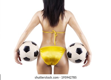 Woman's Sexy Backside Holding a Soccer Ball. isolated on white background