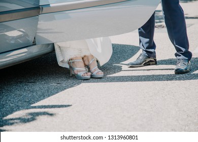 A woman's shoes when getting out of the car on her wedding day