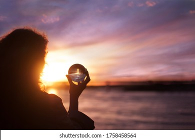 Woman's silhouette on sunset. Catch the moment and mind balance concept. Happiness concept. Young girl looking on water horizon. Closeup portrait.