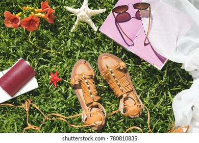 Woman's summer and travel accessories on grass